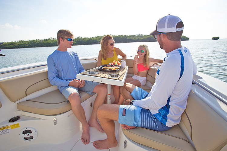 Family sitting and enjoying snacks on the NauticStar 2602 Legacy