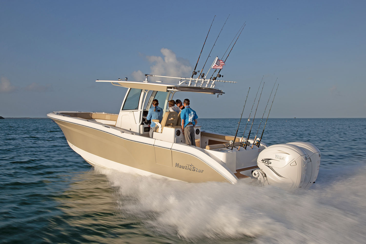 Four men running the NauticStar 32 XS