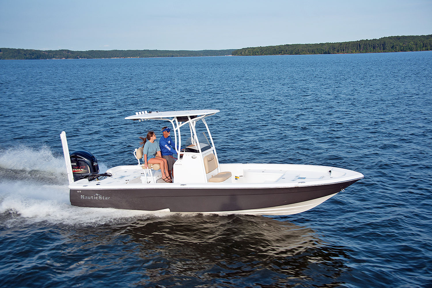 A man captaining the NauticStar 244 XTS with a woman passenger