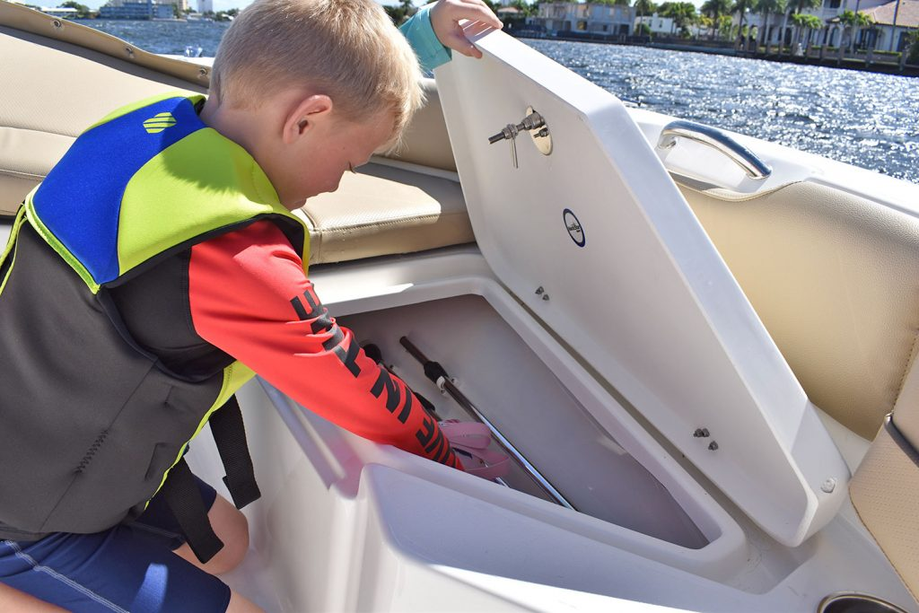 191 hybrid photo with boy opening bow storage hatch