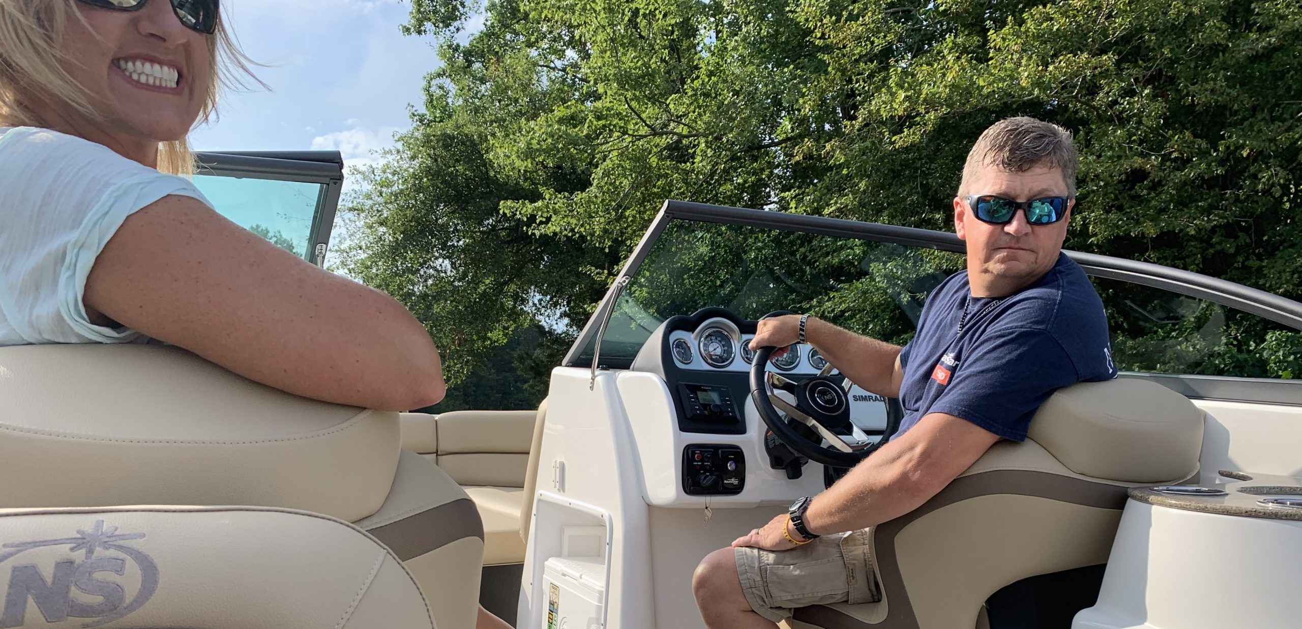 Man and woman launch a NauticStar 243DC boat